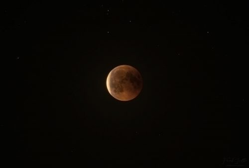 Red moon shortly after emerging from the core shadow of the earth
